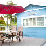 Beachcomber Cottage has a private gated deck with dining and BBQ.