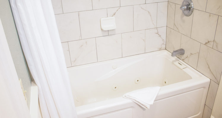 Sea Breeze Room has a jetted tub and shower in the private bath.